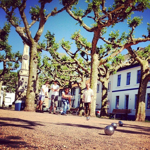 A game of pétanque. This photo is by M.Svitek and the top photo of rosé and pétanque is by XX.