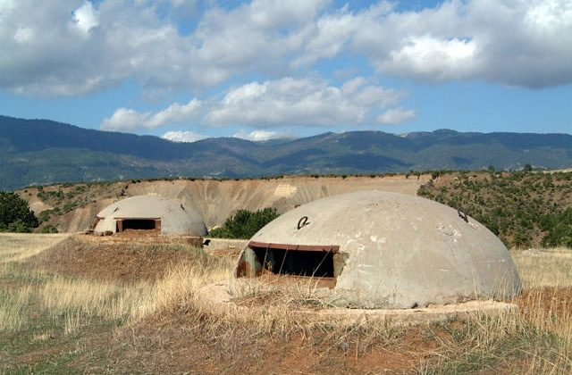 While never actually used to protect soldiers from marauding capitalists, Albania's bunkers have proved popular with horny teenagers. Photo: Marc Morell.