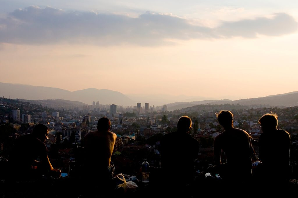 Chatting with a view over Sarajevo. Photo by Semih Hazar.