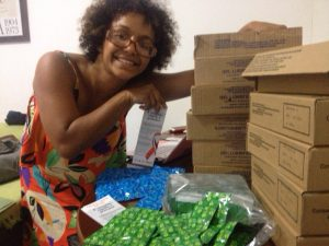 Regiane Moraes prepares condoms and lube for the party.